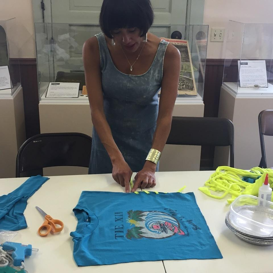 Brandi Shigley shows the Broomfield Museum Depot how to reconstruct t-shirts.